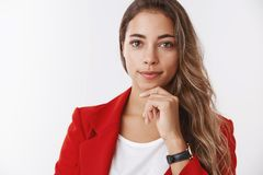 Very interesting keep going. Portrait intrigued businesswoman listening curious suggestion smiling satisfied touching royalty free stock image