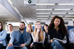 This is very interesting lecture. Group of students sitting in lecture hall stock image