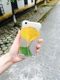 yellow leaf on back of phone case stock images