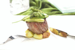 Very irresistible steak with asparagus sauce Stock Photos