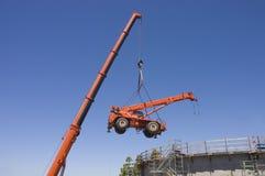 Very large crane lifting small crane Stock Photos