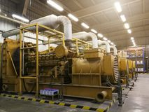 A very large electric diesel generator in factory for emergency,. Equipment plant modern technology industrial Royalty Free Stock Images