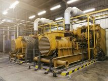 A very large electric diesel generator in factory for emergency,. Equipment plant modern technology industrial Stock Image