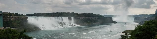 Very large Niagara Falls panoramic view. Cold, cloudy day royalty free stock images