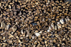 Very large pile of firewood, stacked in an old barn Stock Photo