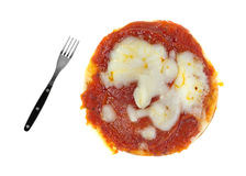 A very large pizza with a small fork Stock Photography
