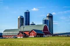 Large red barn with Five Silos stock photography