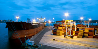 Very large ship in the port during cargo operation Stock Photos