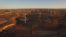 Very large wind turbines array at sunset. Modern Wind turbines large array at dusk, sliding camera in 4K stock video