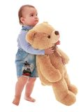 Very little boy carries a Teddy bear Royalty Free Stock Images