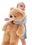 Very little boy hugging big teddy bear. Isolated on white royalty free stock images