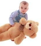 Very little boy with a teddy bear Stock Photos