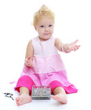 Very little girl with bare feet trying on mom's Stock Images