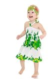 Very little girl in a green summer dress barefoot Royalty Free Stock Images