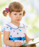 Very little girl reading a book Royalty Free Stock Image