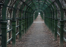 Very long avenue of green wooden arches. Very long avenue of green wooden arches Royalty Free Stock Photography