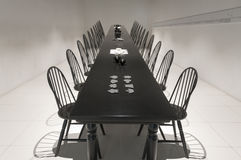 Very long black dining table Royalty Free Stock Image