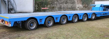 Very long blue truck with six axles of wheels. For exceptional transport royalty free stock image