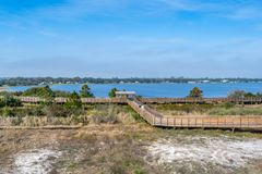 A very long boardwalk surrounded by shrubs in Gulf Shores, Alabama royalty free stock photography
