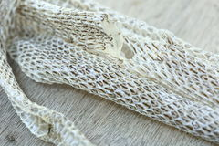 Very Long White Shedding Snake Skin on Wooden Floor Royalty Free Stock Images