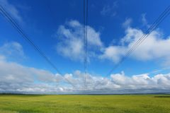 Very long wires and large power transmission poles Royalty Free Stock Photo