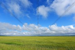 Very long wires and large power transmission poles.  royalty free stock image