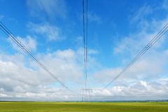 Very long wires and large power transmission poles Stock Photography