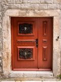 Very low, small brown door made of wood stock photo
