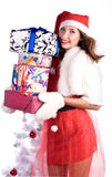 Very many gifts. Pretty woman with xmas gifts royalty free stock image