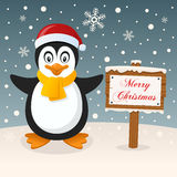 A Very Merry Christmas Sign - Cute Penguin Stock Photo