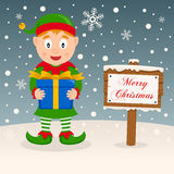 A Very Merry Christmas Sign - Happy Elf Stock Photography
