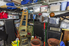Very Messy Garage. With tools, toys, music sports and gardening items stock photo
