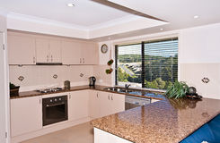 Very Modern Kitchen. A large and very modern kitchen in a new home Stock Photos