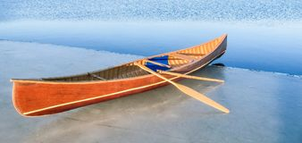 A very motivated person has carried their canoe to the edge of t stock photo