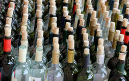 Very much stacked up wine bottles  with  corks Royalty Free Stock Image