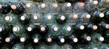 Very much stacked up wine bottles  with  corks Royalty Free Stock Photos