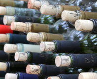 Very Much Stacked Up Wine Bottles With Corks Stock Photos
