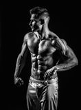 Very muscular handsome athletic man Stock Photos