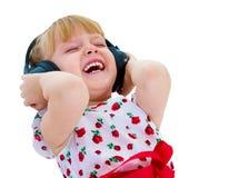 Very musical little girl having Royalty Free Stock Image