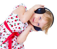Very musical little girl having Royalty Free Stock Images
