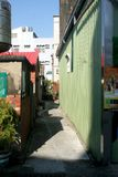 Very narrow alley. This is a real photo photo of the Oriental Seaside Town (Southern Taiwan stock images