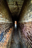 A very narrow brick tunnel in northampton uk.  Royalty Free Stock Photo