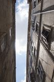 A very narrow street in Rome. The sky is hard to see stock images