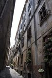 A very narrow street in Rome. The sky is hard to see stock image