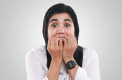 Very Nervous and Worried Young Asian Woman. Photo image portrait of a young beautiful Asian woman looked very nervous and worried, with big eyes on her face Stock Image