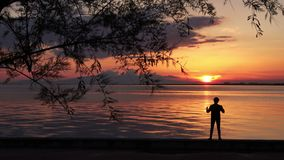 Alone Young Man Standing At Seaside Looking Ocean Sunset. Very Nice Alone Young Man Standing At Seaside Looking Ocean Sunset stock footage