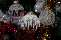 Colorful glowing christmas ball on the tree Royalty Free Stock Images