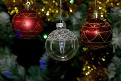 Colorful glowing christmas ball on the tree Royalty Free Stock Photography