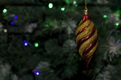 Colorful glowing christmas ball on the tree Stock Photos