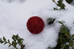 Colorful glowing christmas ball on the snow Royalty Free Stock Photos